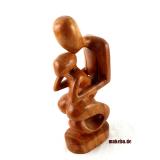 Mutter mit Kind. Geschnitzt aus Odum-Holz Moderne, abstrakte Frauenfigur aus Afrika.